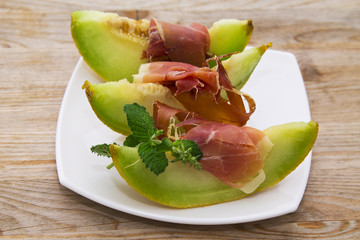 plate of melon with ham