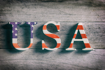 Word USA on wooden background