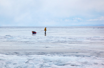 Tourist traveling on Baikal Lake in Siberia at winter