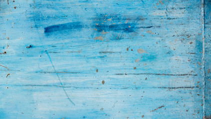 Blue wall background with rough texture dirt and brush strokes