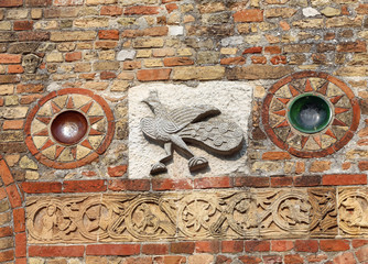 sculpture details on the Pomposa Abbey facade in Italy