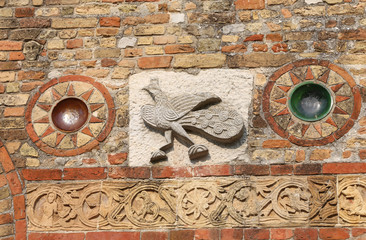 sculpture on the Pomposa Abbey facade in Italy