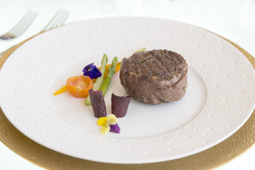 minimalistic dish steak with vegetables