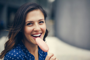 A Young Woman Eating Ice Cream