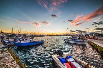 boats in Alghero harbor at dusk