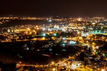 panoramic view of historic town wall and center of jerusalem by night