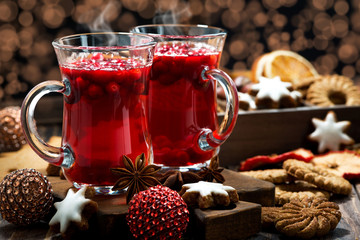 Christmas hot cranberry tea, cookies and light bokeh