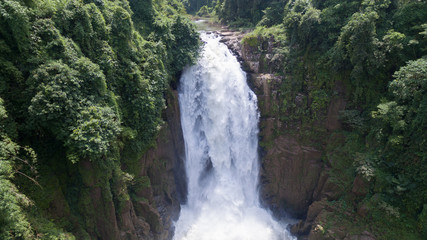 Landscape of Very high Waterfall from cliff in forest, Thailand