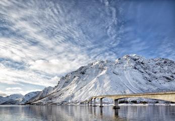 Bridge near Flakstadoya. Lofoten, Norway. The beautiful view under a cloudy sky in Lofoten.