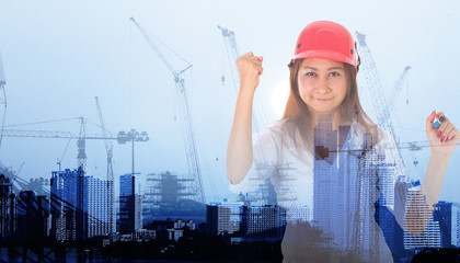 businesswoman with Crane and workers at construction site against blue sky.