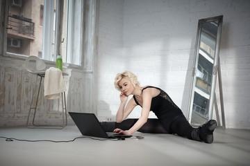Dancer using laptop
