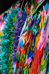 Foto op Canvas Paradijsvogel Strings of colorful paper cranes