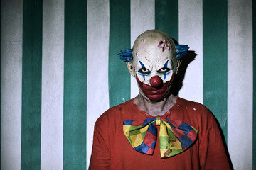 scary evil clown in the circus