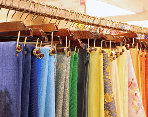 hangers with fabrics and tablecloths on sale in the haberdashery