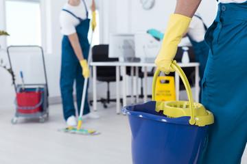 Man holding mop bucket