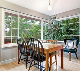 Cozy summer room with dining table set