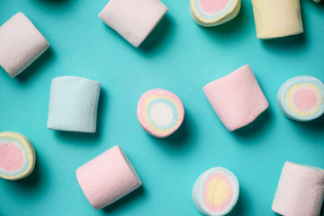 Top view of pastel colored marshmallow on a blue background. Min