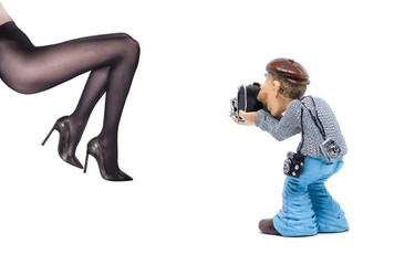 Stock photographer makes a photo of sexy female legs in pantyhose and heels