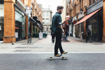 Ireland, Dublin, young skateboarder  on the street