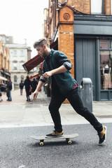 Ireland, Dublin, young skateboarder  on the street