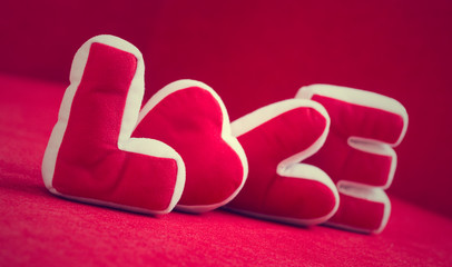 Valentines Day background with Soft pillows make word LOVE on re