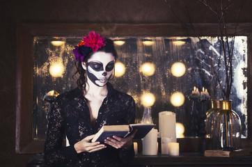 Beautiful woman painted as skeleton. Halloween theme