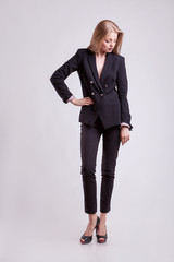 Full body woman in business suit on gray background
