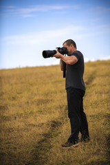 Professional wildlife photographer with equipment