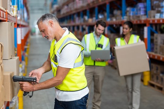 Warehouse worker scanning box