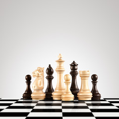 Black and white / Strategy and leadership concept; black and white wooden chess figures standing on the board ready for game.