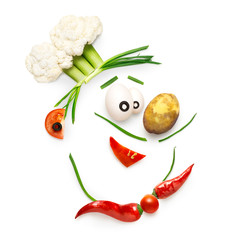 Veggie chef / Creative food concept of a funny cartoon chef face made of vegetables isolated on white.