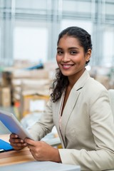 Portrait of smiling manager using digital tablet