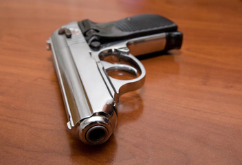 Silver pistol on a table