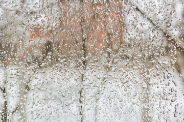 Freezing rain outside the window on a foul winter day
