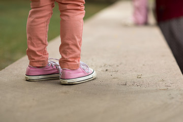 Close Up of kids sneakers walking on street