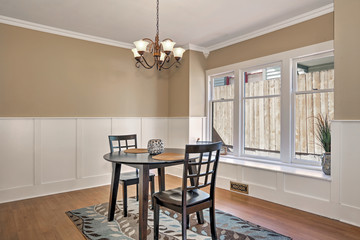 Interior of dining room  with black table and two chairs