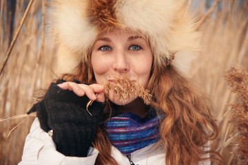 Portrait of one young woman in a meadow in winter