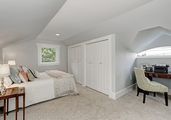 Simply furnished Attic bedroom interior
