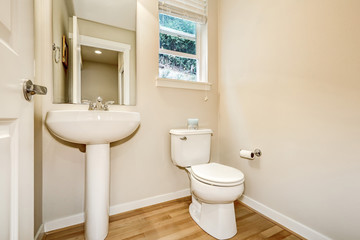 View of washbasin stand and toilet in half bathroom