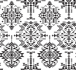 Black and white ethnic seamless pattern with geometric shapes.