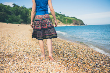 Young woman walking on the beach