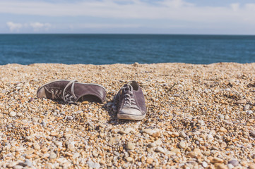 Pair of shoes on the beach
