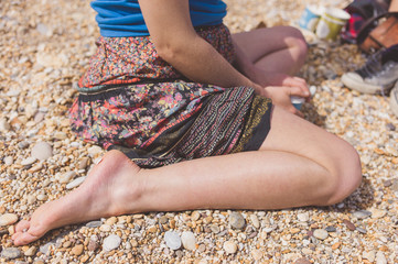 Bare leg of woman on beach