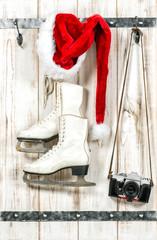 Christmas decoration. Red Santas hat vintage camera ice skates