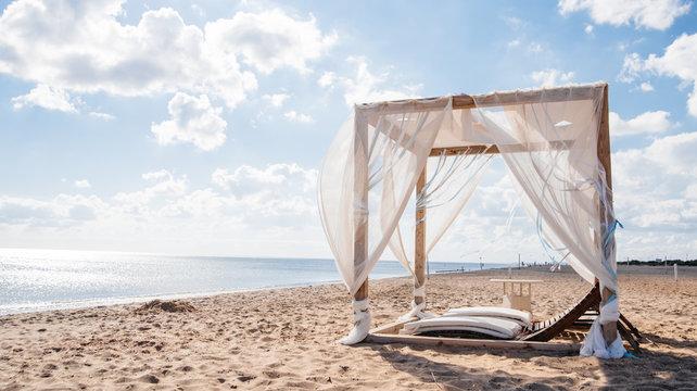 White beach canopies. Luxury beach tents at a resort