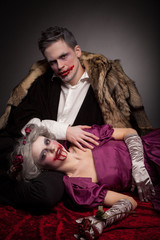 Beautiful vampires couple woman and man in medieval clothes