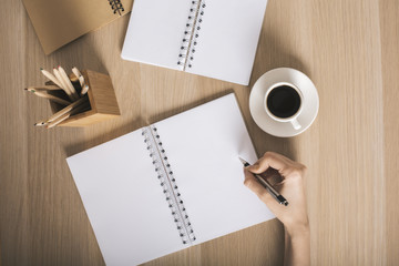 Woman writing in notepad top