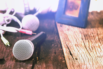 The microphone on the old wooden floor