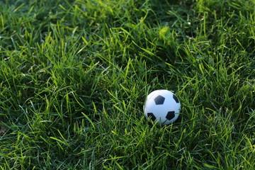 Football ball on field. Close up