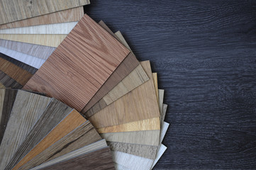 Laminate Wood Concept - Samples of laminate and vinyl floor tile on wooden Background wo